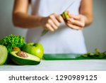 green fruits on front. woman... | Shutterstock . vector #1290989125