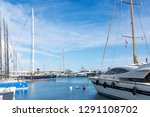 yachts and sailboats in marina... | Shutterstock . vector #1291108702