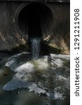 water  from sewer water flowing ... | Shutterstock . vector #1291211908