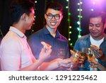 positive vietnamese men... | Shutterstock . vector #1291225462
