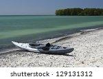 Kayak Sitting On The Sandy...