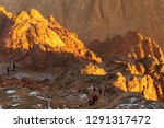 the sun rises behind the rock.... | Shutterstock . vector #1291317472