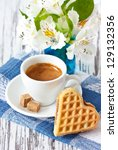 Sweet heart waffle and cup of coffee with brown sugar. - stock photo