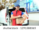 young courier with parcel and... | Shutterstock . vector #1291388365
