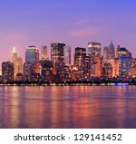 Stock photo new york city manhattan downtown skyline at dusk with skyscrapers illuminated over hudson river 129141452