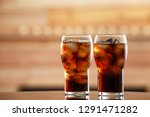 glasses of cola with ice on... | Shutterstock . vector #1291471282