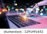 robotic cyborg hand pressing a... | Shutterstock . vector #1291491652