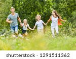 happy family and kids run... | Shutterstock . vector #1291511362