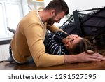 young couple lying down on... | Shutterstock . vector #1291527595