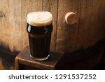 pint glass of dark stout beer... | Shutterstock . vector #1291537252