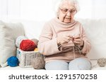 grandmother knitting with... | Shutterstock . vector #1291570258