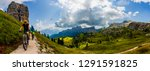 couple cycling in cortina d... | Shutterstock . vector #1291591825