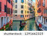 narrow canal with gondola and...   Shutterstock . vector #1291662325