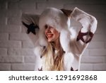 model in winter hat   beautiful ... | Shutterstock . vector #1291692868