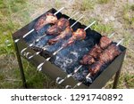 russian barbecue on the grill ... | Shutterstock . vector #1291740892