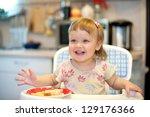 beautiful little girl laughing... | Shutterstock . vector #129176366