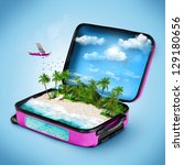 open suitcase with a tropical... | Shutterstock . vector #129180656
