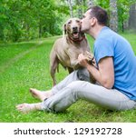 Stock photo happy man with his dog outdoors 129192728