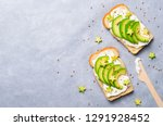 avocado toasts with cream... | Shutterstock . vector #1291928452