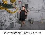 girl blonde child in a black... | Shutterstock . vector #1291957405