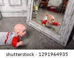 cute newborn baby in red with... | Shutterstock . vector #1291964935