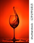 wine glass. splashes on a red... | Shutterstock . vector #1291991815