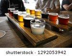 twelve beer samples being... | Shutterstock . vector #1292053942
