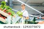 woman working in a supermarket...   Shutterstock . vector #1292075872