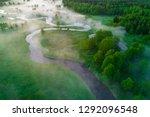 spring foggy dawn. aerial... | Shutterstock . vector #1292096548