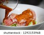 marinating raw chicken breasts... | Shutterstock . vector #1292153968
