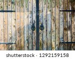 old wooden gate with forged... | Shutterstock . vector #1292159158