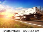 flatbed truck and cars in... | Shutterstock . vector #1292165125