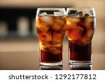 glasses of cola with ice on... | Shutterstock . vector #1292177812