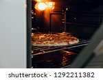 pizza baked in the oven. a view ... | Shutterstock . vector #1292211382
