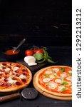 pizza margarita and pepperoni | Shutterstock . vector #1292213212