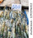 stack of fresh shrimp in the... | Shutterstock . vector #1292296312