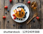 delicious pancakes with... | Shutterstock . vector #1292409388