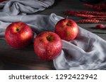 fresh red apples on wooden table | Shutterstock . vector #1292422942