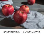 fresh red apples on wooden table | Shutterstock . vector #1292422945