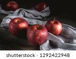 fresh red apples on wooden table | Shutterstock . vector #1292422948