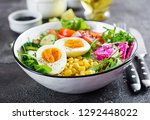 fresh salad. bowl with fresh... | Shutterstock . vector #1292448022