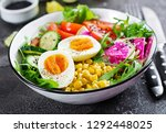 fresh salad. bowl with fresh... | Shutterstock . vector #1292448025