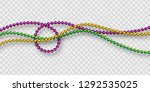 Mardi Gras beads in traditional colors. Decorative glossy realistic elements. Isolated on transparent background.Vector illustration