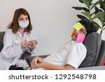 young asian female doctor with... | Shutterstock . vector #1292548798