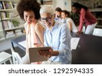 successful group of business... | Shutterstock . vector #1292594335