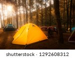 camping and tent under the pine ... | Shutterstock . vector #1292608312