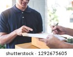 delivery mail man giving parcel ... | Shutterstock . vector #1292675605