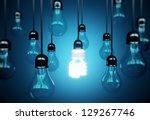lightbulbs on blue background ... | Shutterstock . vector #129267746