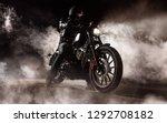 dark motorcycle driver in fog.... | Shutterstock . vector #1292708182