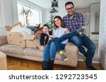 happy family moving home with... | Shutterstock . vector #1292723545